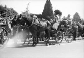 [Mrs. Gertrude Redford, Mrs. W.E. Crawford, Mr. W.J. Mcguigan and Juan Root in a horse drawn carr...