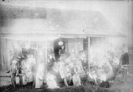 [Group assembled on front porch of John Linn's cottage, Lynn Creek]
