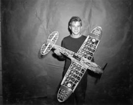 Young boy with model airplane
