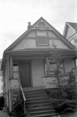 House with fretwork under front gable, in 1400 block of West Tenth Avenue on south side of street