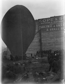 [A hot air balloon being inflated during a carnival on the Cambie Street grounds]