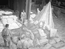 "St. Regis Paper Company [loading ""Renown"" Brand flour for export to China]"