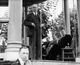 Unidentified man speaking at Canada Pacific Exhibition opening