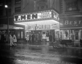 "[Exterior view of the Orpheum Theatre showing the posters and displays for the ""T-Men"" ..."