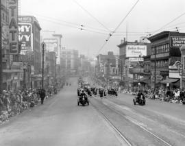 View of floats and bands along 100 block East Hastings Street during 1949 P.N.E. Opening Day Parade