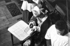 [Archbishop A.U. De Pencier signing the sentence of consecration at St. James' Church]
