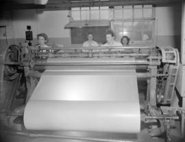 [Large sheet of paper being rolled by a machine at Westminster Paper]