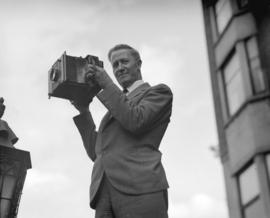 Shell Oil Co. - Super Shell campaign - Stuart Thomson holding Goerz Anschütz press camera