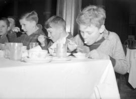 [Children eating at a New Year's celebration]