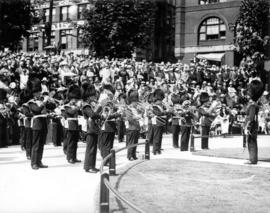 H.M. Coldstream Guards band performing in front of crowd