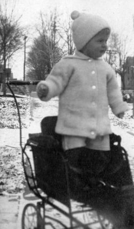 Horton Cooley Kessler [standing in stroller]