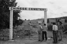 Pender Guy volunteers and an older man at the entrance to the Chinese Cemetery, Kamloops, B.C.