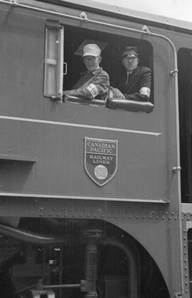 [C.P.R.Engineer and station master aboard locomotive 2850]