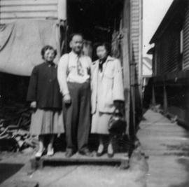 Lillian Ho Wong, Foon Wong, and Winnifred Eng at the  alley entrance to 350 East Pender Street