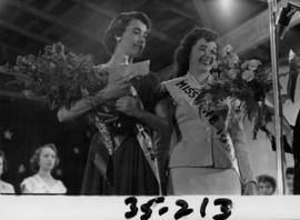 Nancy Hansen poses with Lynn Adcock, Miss P.N.E. 1953 after being named Miss P.N.E. 1954