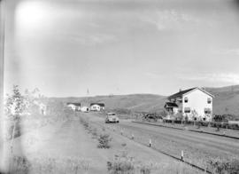 View of houses [and road in] Turner Valley
