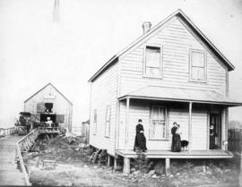 [Exterior of T.J. Janes residence and Livery and Feed Stable - Westminster Avenue (Main Street) L...