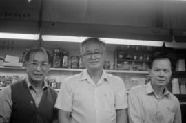 Bill Wong and Jack Wong of Modernize Tailors, with another man