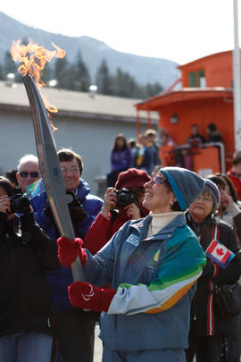 Torchbearer 9 Patsy Seward carries the flame in Lytton, BC