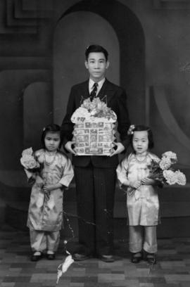 Portrait of man and two girls