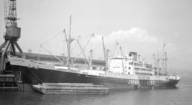 M.S. Korai Maru [at dock, with barges alongside]