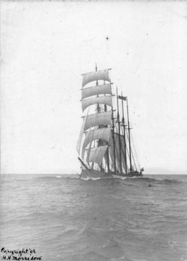 [A six-mast ship at sea]
