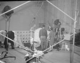 [People at work on a television or movie set]