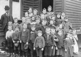 [A class outside East South Vancouver (Carlton) School on Joyce Road (Street) and Westminster Roa...