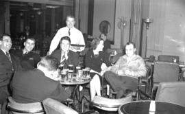 [Group seated in a beer parlour]