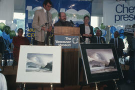Michael Francis and Toni Onley at the podium during Vancouver's 99th birthday celebration