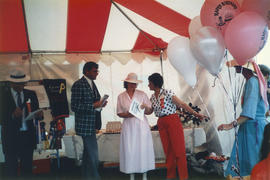 Michael Francis and two women under canopy at Southlands Summer Show