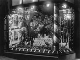 [Johnson and Salsbury's window at 90 Lonsdale Avenue showing a display for the visit of the ...