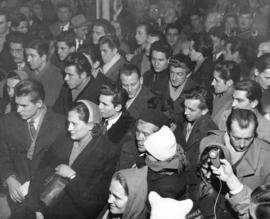 [Hungarian refugees gather in the Immigration Building at the airport]