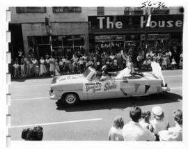 Mission City Strawberry Queen in decorated car during 1956 P.N.E. Opening Day Parade