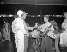"[Man with a model airplane receiving a trophy at a promotional event for ""Blaze of Moon&quot..."