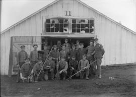[Group of soldiers with gardening tools]