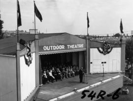 Col. the Hon. C. Wallace, Lieutenant Governor, speaking on Outdoor Theatre stage at 1954 P.N.E. o...