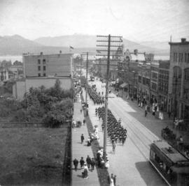 "[View of ""Blue jackets"" marching north of Georgia Street on Granville Street for the ar..."