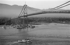 [Ship approaching the Lions Gate Bridge under construction]