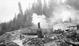 Vancouver East [storage tank construction site -steam donkey and cordwood]