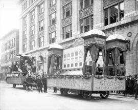 [B.C. Electric Railway Company floats showing Vancouver's first streetcar, and a model of the Bun...