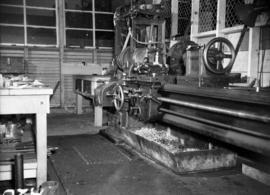 Large machine lathe in shipyard shop