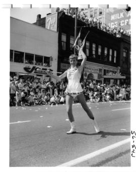 Young woman dancing in 1956 P.N.E. Opening Day Parade