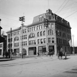 The MacKinnon Block (later the Williams Block) at the southwest corner of Hastings and Granville ...