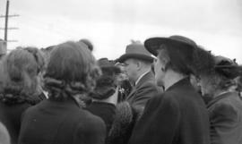 [Alderman Halford Wilson surrounded by a crowd during a meeting at the Cambie Street Grounds]