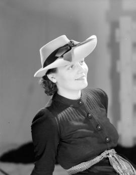 [Woman modelling a hat for] Spencer's catalogue