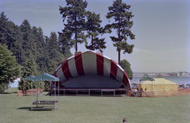 Stage under red and white striped canopy