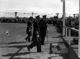 [King George VI returns to reviewing stand after presentation of regimental colours at Beacon Hil...