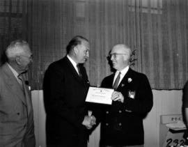 P.N.E. President J.S.C. Moffitt presenting Canadian Pacific Airlines C.E.O. G. McConachie with ho...