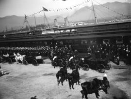 [Assembled sailors, dignitaries, and carriages at C.P.R. station for visit of Duke and Duchess of...